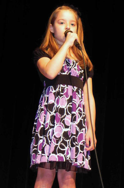 "Fourth-grader Payton Lemmon sings ""Your Hands"" during ""Waynesboro ... You've Got Talent"" Saturday at Waynesboro (Pa.) Area Senior High School."