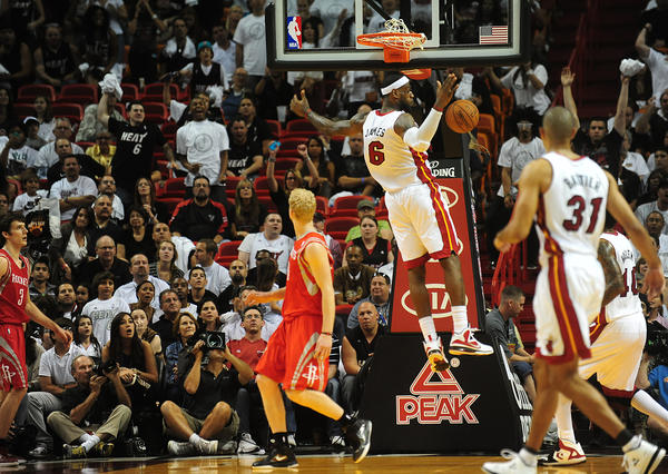 LeBron James of the Miami Heat scores a last dunk in the closing minutes against the Houston Rockets, Sunday, April 22, 2012 at the AmericanAirlines Arena in Miami.