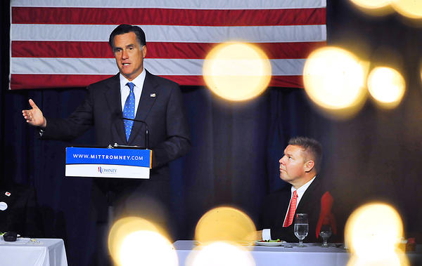 Pa. State Sen. Richard Alloway, R-Franklin/Adams/York, listens as Mitt Romney speaks Sunday at the Franklin County Republican Committee's Lincoln Day Dinner at Green Grove Gardens near Greencastle, Pa.