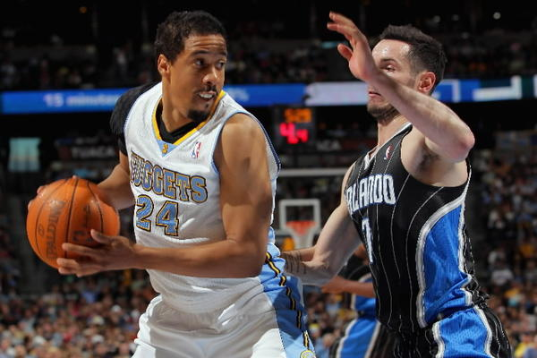 Andre Miller #24 of the Denver Nuggets controls the ball against J.J. Redick #7 of the Orlando Magic at Pepsi Center on April 22, 2012 in Denver, Colorado. The Nuggets defeated the Magic 101-74.