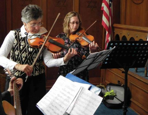 Emily Beaton and Barb Eshelman perform during the 34th annual Holocaust Memorial Service at Congregation Sons of Israel in Chambersburg (Pa.) on Sunday.