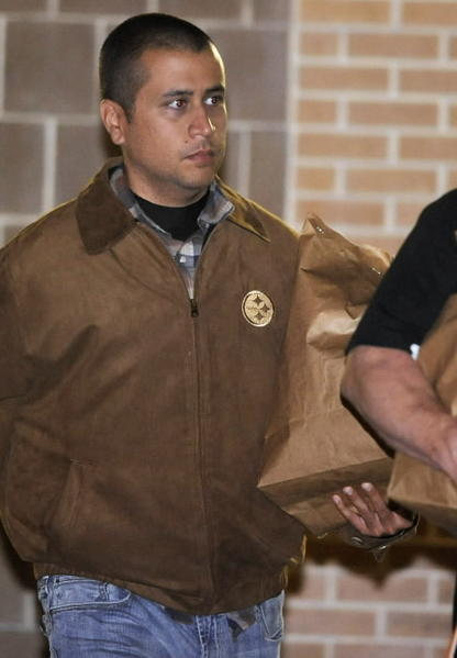Neighborhood watch volunteer George Zimmerman leaves the Seminole County Jail after posting bail in Sanford, Florida, April 22, 2012. Zimmerman, standing trial on a charge of second-degree murder in the death of unarmed black teenager Trayvon Martin, was granted $150,000 bail by a judge on Friday.