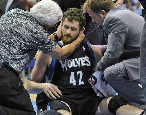 Kevin Love is examined by a doctor after he took a shot to the head during an April 11 game.