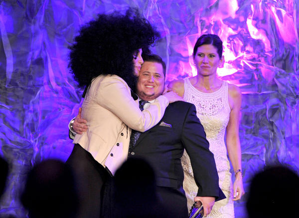 Cher (L) and Rep. Mary Bono Mack (R) present an award to Chaz Bono (C) onstage at the 23rd Annual GLAAD Media Awards
