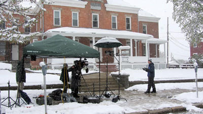 Meteorologist Eric Fisher gives a live broadcast on the Weather Channel Monday near the Courthouse in Somerset.
