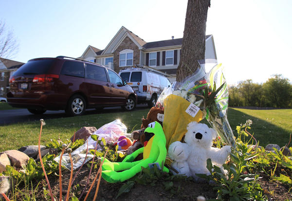 A memorial of teddy bears, stuffed animals, and flowers surround a tree out in front of Allan Fernandez's home in Hoffman Estates. Fernandez, 11, died Saturday of a puncture wound to the chest.
