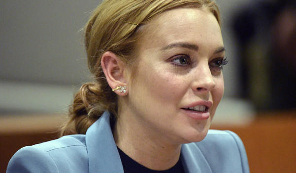 Lindsay Lohan attends a March 29 probation progress report hearing at Superior Court in L.A. The actress was released from probation for a 2007 drunken driving case and will not have to appear in court for her 2011 shoplifting case as long as she obeys all laws through May 2014.