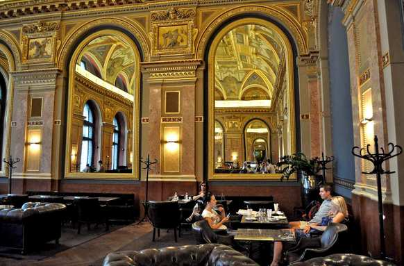 Inside Bookcafe Kavezo, which was built in the late 19th century, huge wall mirrors reflect neo-Renaissance ceiling murals by Karoly Lotz.