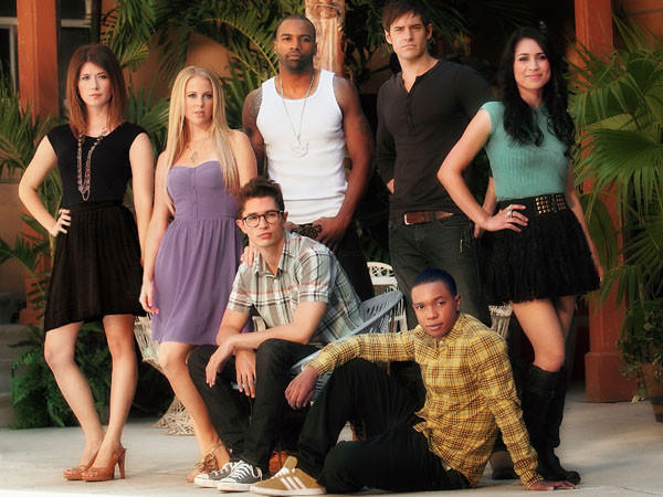 Jewel Staite (standing, left to right), Chelan Simmons, Andra Fuller, Jonathan Patrick Moore and Cassie Steele; Joe Dinicol (sitting, left to right) and Benjamin Charles Watson.