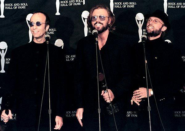 The Bee Gees appear backstage after they were inducted into the Rock and Roll Hall of Fame during a ceremony at Cleveland's OH hotel.