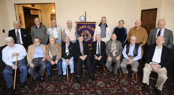 "World War II veterans were honored Monday night by the Hancock Lions Club at the Park-N-Dine on East Main Street in Hancock. Veterans who attended and were honored included, seated left to right, Bill Yoho, Clyde Golden, Ed Michael, Charles Webster, Arless Kesecker, Bob Rowland, Glenn Ward and Ralph ""Buddy"" Wachter. Standing from left are Ervin Price, Harry Strock, George A. Johnson, Paul Dodson, Jim Redick, Ernst Shives, Millard Creek, Joe Price and Lloyd Pittman."