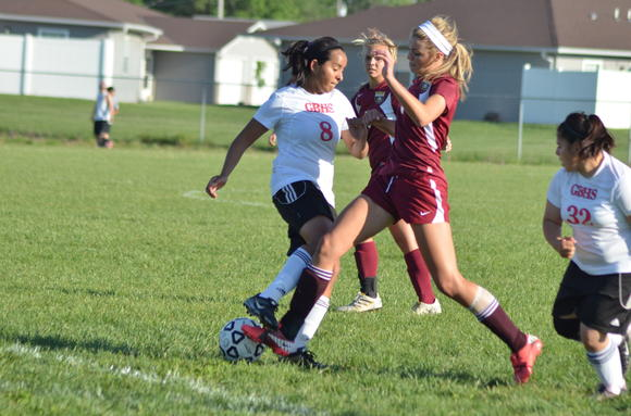 Hays junior Taylor Herman battles Great Bend's Abigail Arias for the ball Tuesday. Herman had two goals in a 3-2 win.