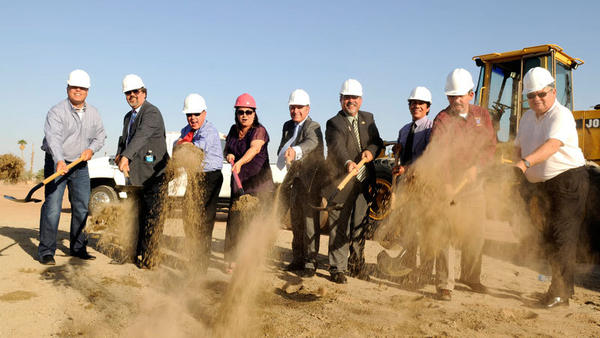 FROM LEFT: Former Calexico Mayor Louis Fuentes, City Manager Oscar Rodriquez, Councilman Bill Hodge, Mayor Pro Tem Maritza Hurtado, Developer Arman Gabay, Mayor Daniel Romero, Councilman Luis Castro, Councilman John Moreno and Imperial County Supervisor John Renison throw dirt during the ceremonial groundbreaking for the long-awaited  Gran Plaza outlet center project.