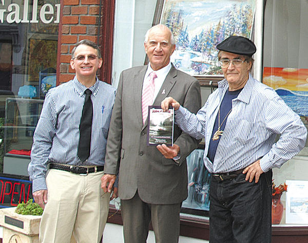 "From left, Dr. Nicholas Orfan, Hancock Town Councilman Nigel Dardar and artist George Petridis attended a book-signing April 15 for ""Destiny Of An Artist  The Artistic Journey of George Petridis"" in front of Contemporary School of the Arts & Gallery Inc. in Hagerstown."