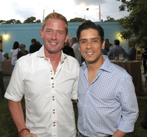 "John Michalski, left, and Juan Rojas at H.O.M.E.S.' (Housing Opportunities, Mortgage Assistance and Effective Neighborhood Solutions, Inc.) ""Cuban Pig Roast in the Garden,"" which took place at its administrative offices located in Fort Lauderdale."