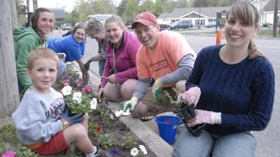 Volunteers plant petunias along U.S. 31 in Charlevoix as part of Keep Charlevoix Beautiful's Operation Petunia initiative in 2009. The annual streetside beautification effort has been cited as one local example of a placemaking contribution.