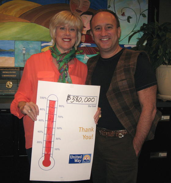 Drs. Sally and Louis Cannon mark completion of Char-Em United Way's 2011/12 campaign.