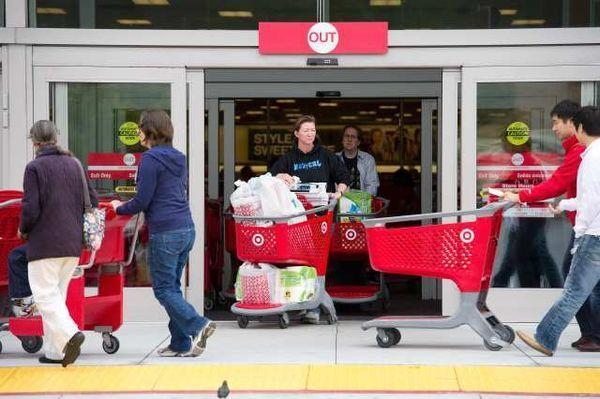 Customers leave a Target store in Colma, Calif. Consumer confidence is stable, but Americans still aren't in their best mood, according to reports from the Conference Board and Gallup.