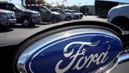 Fitch boosted Ford's credit rating to investment grade.