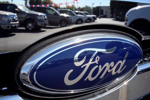 Fitch boosted Ford's credit rating to BBB-minus from BB-plus.