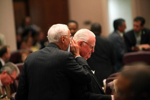 Ald. Richard Mell whispers to Ald. Ed Burke during last week's City Council meeting.