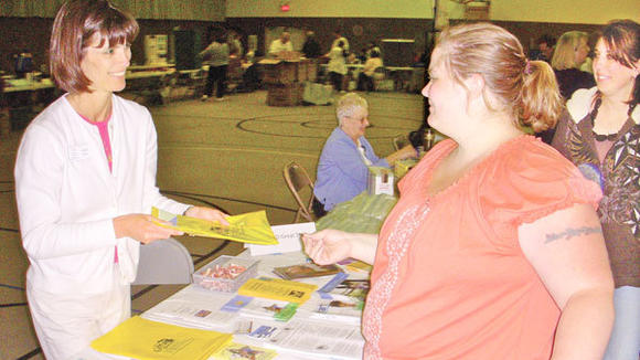 Otsego County Great Start Parent Coalition parent liaison Colleen Gorno (l) talks to Tonya Allmacher about the program during last year's Community  Connect. This year's event is May 10.