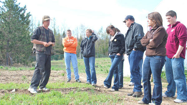 Ivan Witt (l) discusses the benefits of growing his own food during a portion of Leadership Otsego Countys environment module that toured his farm last week. Pictured next to Witt are current Leadership Otsego County students (l-r): Bob Felt, Dana Bensinger, Monica Graham, Allen Ballard, Karen Matelski and Jeremy Speer.