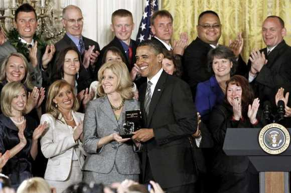 President Barack Obama presents the 2012 National Teacher of the Year award to Rebecca Mieliwocki, who teaches at Luther Burbank Middle School in Burbank, Calif., Tuesday, April 24, 2012, during a ceremony in the East Room at the White House in Washington.