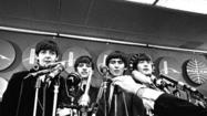 NEW YORK (AP) — The Beatles are hitting theaters nationwide.