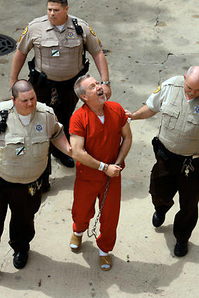 "Drew Peterson shouted ""Look at my bling"" as he was led into the Will County Courthouse in Joliet for arraignment on charges he killed his third wife, Kathleen Savio."