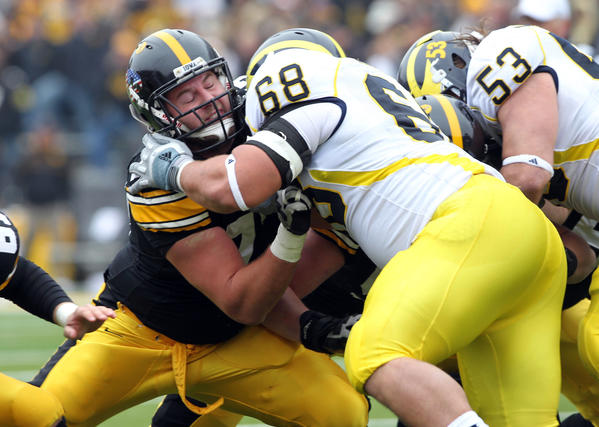Pick: 23, Player: Riley Reiff, Team: Lions, Position: OT, School: Iowa,  Reiff bounced around the line as a freshman, playing at various spots before replacing Bryan Bulaga (a first-round pick of the Packers) at left tackle as a sophomore. Reiff started all 13 games at left tackle as a junior before deciding to turn pro early. If there's a knock on him, it's that his arms are a tad shorter than typical for a left tackle. -Sam Farmer, Tribune Newspapers