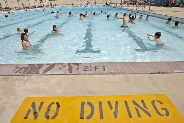 Swimmers enjoy a cool dip in the McCambridge swimming pool. Burbank was awarded a $7,000 grant Tuesday that will offset the cost of swimming classes, lifeguard lessons and events.