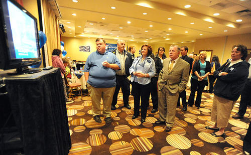 Matt Carwright supporters gather around the television to watch the early numbers at the Scranton Hilton Tuesday night.