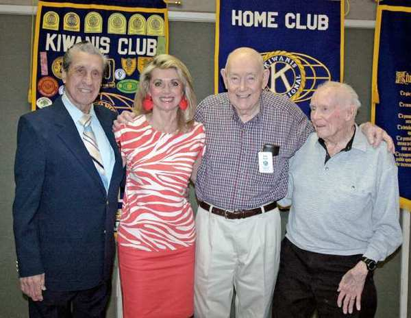 Preparing to celebrate the 90th anniversary of the Kiwanis Club of Glendale are, from left, past president Jim Bishop, current President Susan Dell, and members Lou Yaussi and Irv Currier. Bishop, Yaussi and Currier are all 90 years old.