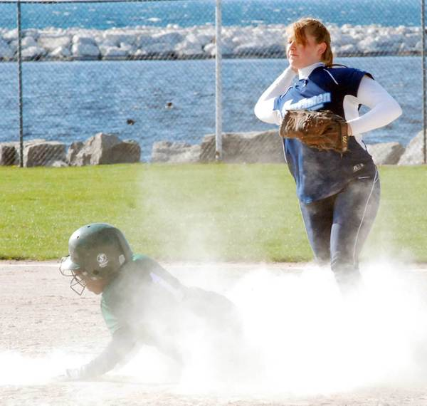 Petoskey second baseman Tori Thompson (right) gets set to throw to first base after forcing out an Alpena baserunner at second Tuesday during a Big North Conference doubleheader at Ed White Field.