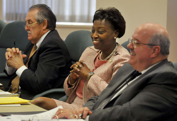 Lillian Lowery, at the state board of education meeting, center, sitting between the interim superintendent Dr. Bernard Sadusky, left, and Steve Brooks, deputy state superintendent for finance. Lowery was officially voted in to her new position as State Superintendent of Schools.