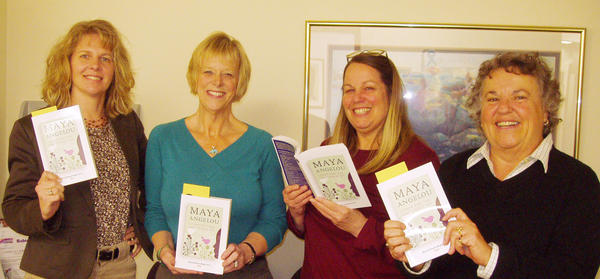 Maurine Watts (second from left) and representatives from the Women's Resource Center of Northern Michigan, (from left) Gail Kloss, finance director; Deb Smith, assistant director; and Jan Mancinelli, executive director, look over books donated to the agency as a part of World Book Night, an event which took place across the nation on Monday, April 23.