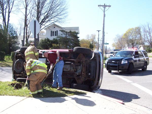 Officials respond to two-vehicle crash, in which one rolled over, at Howard and Grove streets.