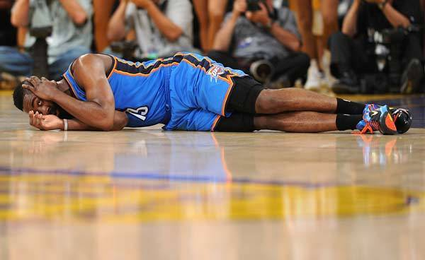 Oklahoma City Thunder guard James Harden (13) lays on the floor after a flagrant foul by Los Angeles Lakers small forward Metta World Peace (not pictured) who was ejected in the second quarter of the game at the Staples Center. World Peace has been suspended for seven games.