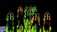 How do you merge the music and dancing of Michael Jackson with the performers of Cirque du Soleil?