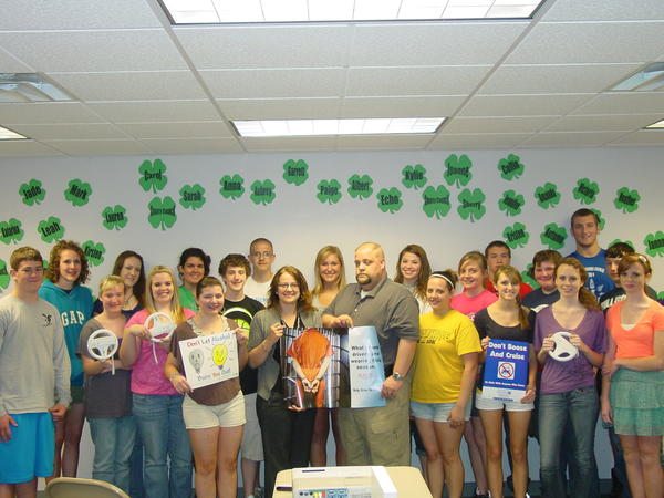 4-H County Council observed National Youth Safety Month. 4-H County Council members are shown along with Ronna Yablonski from Twin Lakes Center and Officer Rich Appel from the borough police department.