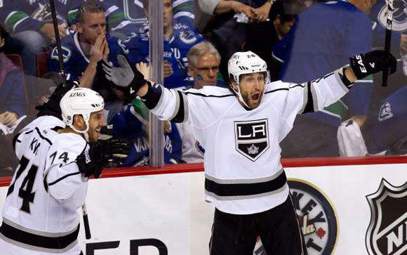 Jarret Stoll, right, and Dwight King celebrate after Stoll scored the game-winning goal against the Vancouver Canucks in the opening round of the playoffs.
