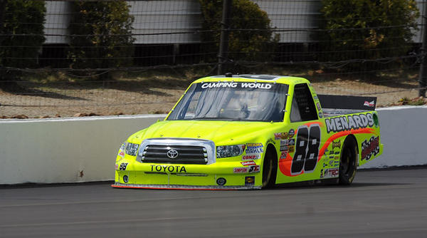 Matt Crafton driver of the #88 Jeld-Wen/Menards Toyota from the NASCAR Camping World Trucks series, navigates down the front straightway during the Goodyear tire test on the new racing surface at Pocono Raceway Wednesday.
