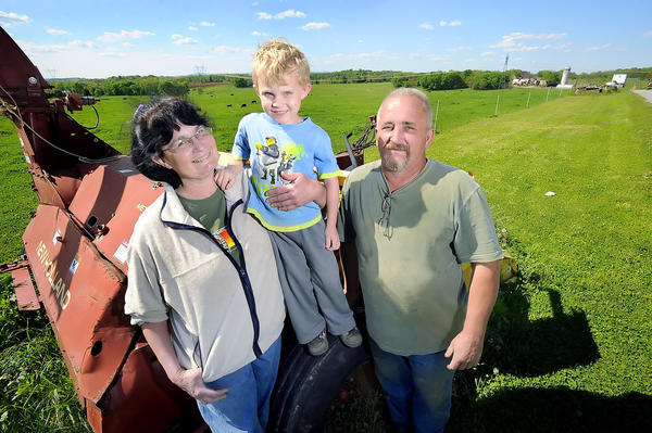 Katherine Ecker, her grandson Landon Hutzell, 5, and husband Sam Ecker stand near the entrance to their Legacy Manor Farm near Sharpsburg, which will host the 150th anniversary re-enactment of the Battle of Antietam planned for Sept. 14-16.