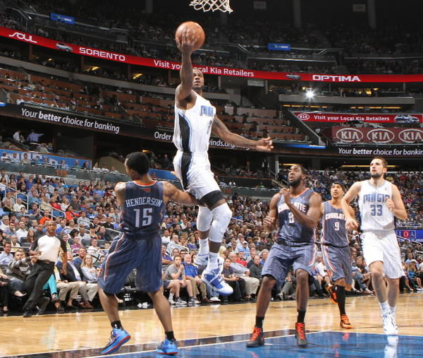 Orlando forward Earl Clark drives to the basket over Charlotte forward Gerald Henderson (15) during the first half of the Magic's game against the Bobcats in Orlando, Fla. Wednesday, April 25, 2012. (Gary W. Green/Orlando Sentinel)