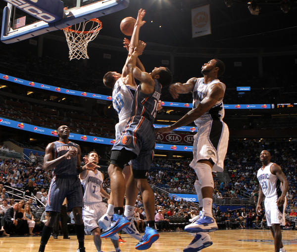 Charlotte forward Gerald Henderson (15) runs into Orlando forwards Ryan Anderson (33) and Earl Clark (3) during the second half of the Magic's 102-95 victory over the Bobcats in Orlando, Fla. Wednesday, April 25, 2012.