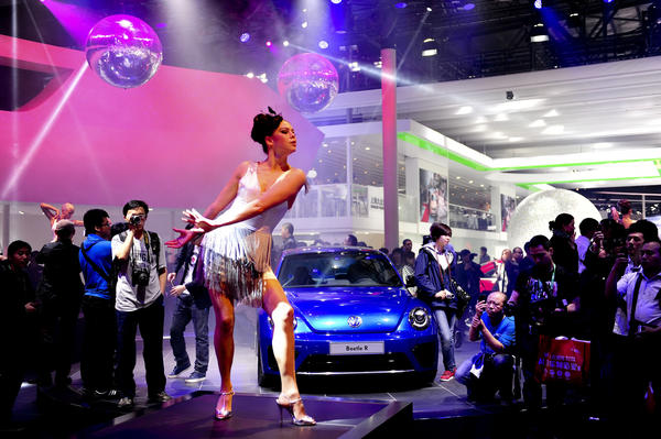 A dancer performs during the Auto China 2012 exhibition in Beijing on April 26, 2012. Carmakers at the Beijing auto show are due to unveil scores of clean energy vehicles as they try to convince Chinese customers to swap gas-guzzling SUVs for cleaner but slower and pricier options.