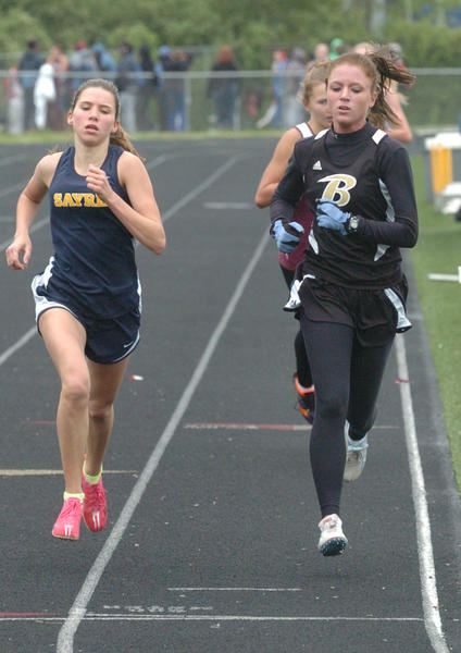 Boyle County senior Maddie Kriz, right, has school records, a state title and scholarship money still to run for as the shortened track and field season begins to wind down. Boyle County host its invitational on Friday, and Kriz is excited to get to run on her home track one last time.