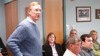 Boyne City manager Mike Cain speaks Wednesday at the Charlevoix County Board of Commissioners meeting. He wants the county to continue to perform property assessing services for the cities, he said.