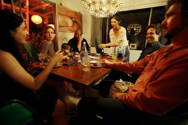 Three families enjoy dinner in a Silver Lake home -- from left, Melissa Vergara, Marissa Engel, Engel's son Mars Dixon, Eric Dixon, Carla Choy, Billy Czyzyk, and Keith Patterson. Marissa Engel of Hollywood wants to live in a more connected world. In a concept she calls supper surfing, she arranges for strangers to have dinner with strangers and perhaps start up friendships while breaking bread.
